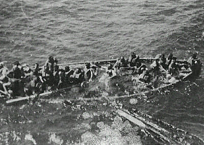 Life boat from SS Tilawa in process of sinking due to overloading. Person in white clothing in centre of picture is thought to be captain F.Robertson