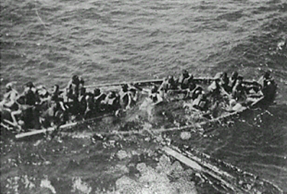 Life boat from SS Tilawa in process of sinking due to overloading. Person in white clothing in centre of picture is thought to be captain F.Robertson.